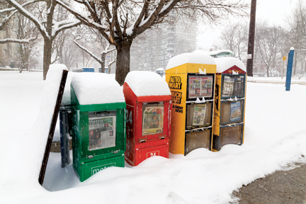 Newspaper Bins in the Snow in Toronto.