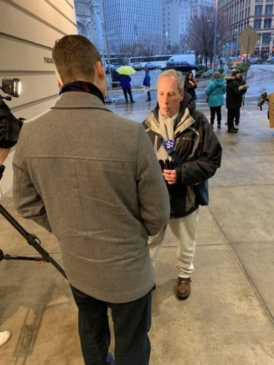 Pittsburgh P-G Leafletting 2019-1214 Fuoco talking to reporter